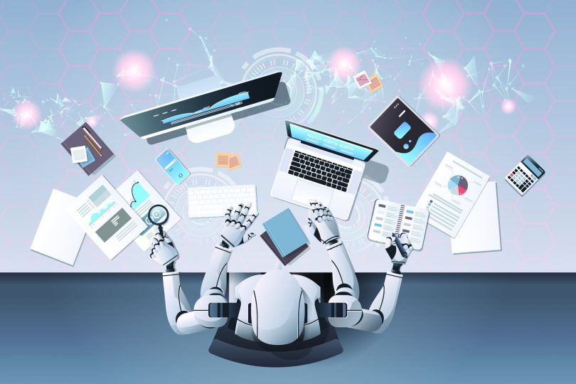 Adobe Stock 255861089 robot working at computer